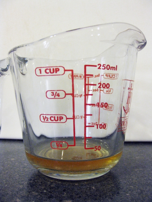 1 Tablespoon Apple Cider Vinegar in Measuring Cup